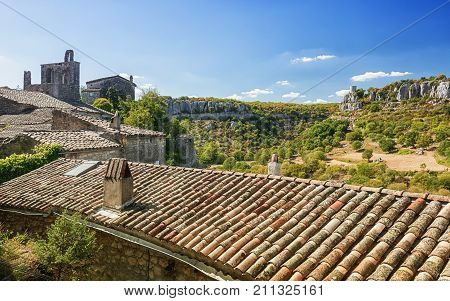 Top view of the rooftops of the village Balazuc and the valley of the river Ardèche poster