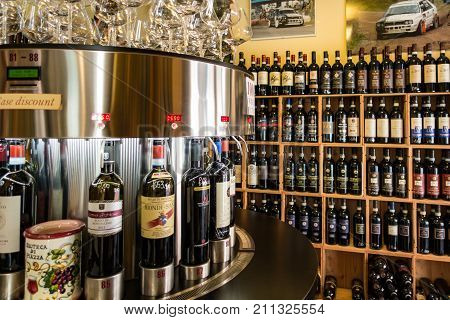 Tuscany Italy - May 5 2017: Wine store has rows of wine plus an automated tasting bar
