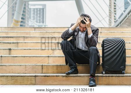 Unemployed businessman stress sitting on stair concept of business failure and unemployment problem work life balance.