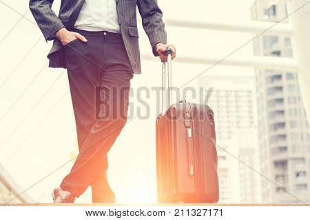 Businessmen are standing in the morning sunrise business man going to the airport with luggage concept of business transportation and traveling holiday leave weekend.