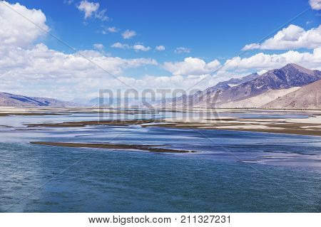 Typical landscape of Tibet - Holy Brahmaputra river, Yarlung Tsangpo, and mountain landscape - Tibet