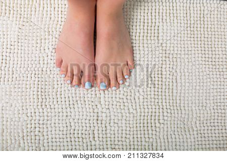 Woman Feet With A Blue Pedicure