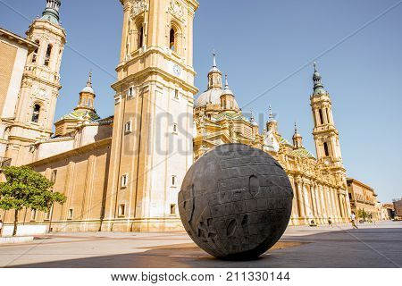 ZARAGOZA, SPAIN - August 20, 2017: View on the cathedral of Our Lady of the Pillar with Earth monument on the central square in Zaragoza city, Spain
