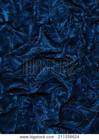 CLOSE UP OF DARK BLUE VELVET FABRIC BACKGROUND