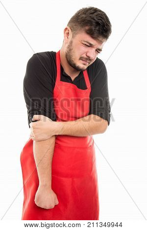 Male Supermarket Employer Holding Elbow Like Hurting