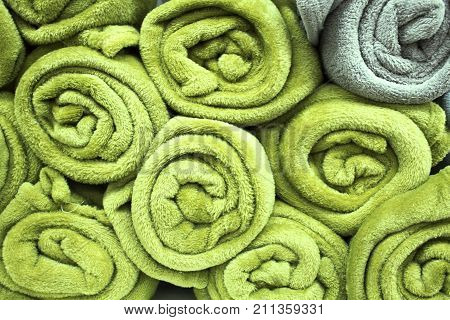 Lots of rolled towels in the storage