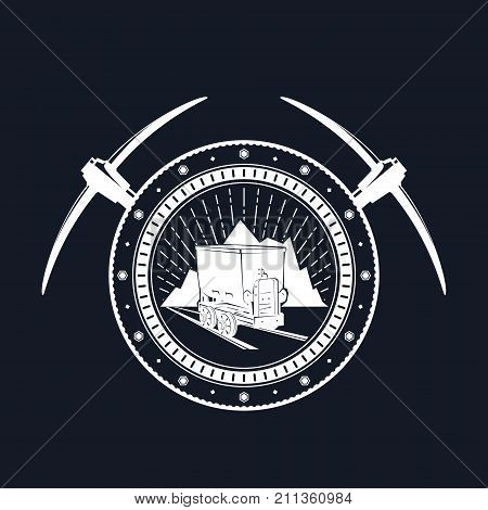 Vintage Emblem of the Mining Industry Coal Mine Trolley against Mountains and Sunburst in a Gear with Two Crossed Pickaxes jy a Black Background Label and Badge Mine Shaft Vector Illustration