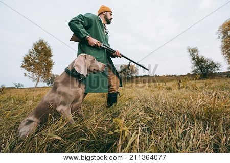 Hunter Going With Gun And Dog