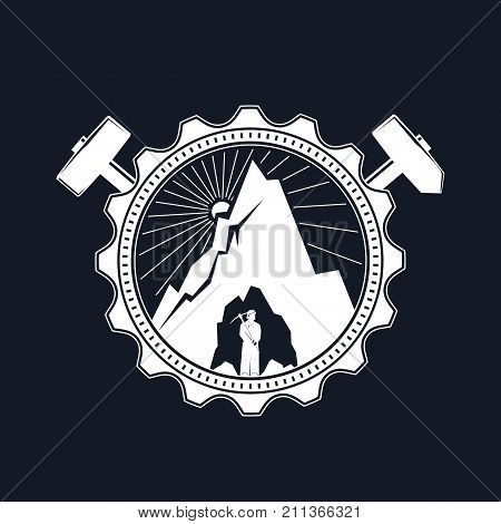 Miner in the Helmet is Holding Pickaxe in the Bowels of the Mountain on a Background of the Sunburst in a Gear with Crossed Hammer and Sledgehammer Mining Industry Vector Illustration