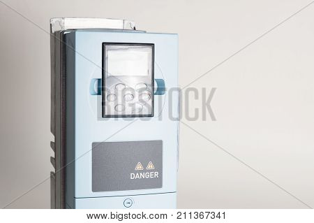 A new universal inverter for controlling the electric current and power for industrial on a gray white background. A frequency converter - rectifier - power stabilizer poster