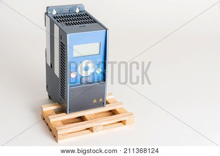 A new universal inverter for controlling the electric current and power for industrial on a gray white background. A frequency converter - rectifier - power stabilizer