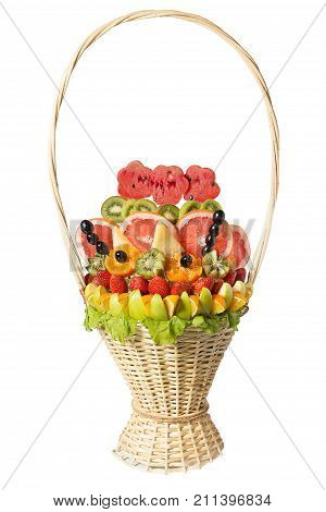Gift basket with fruits and sweets. Basket with fruits and berries in chocolate isolated on white background. Handmade. Strawberries, grapes, citrus, apple, kiwi and pineapple.