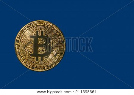 golden shiny coin bitcoin on a blue background