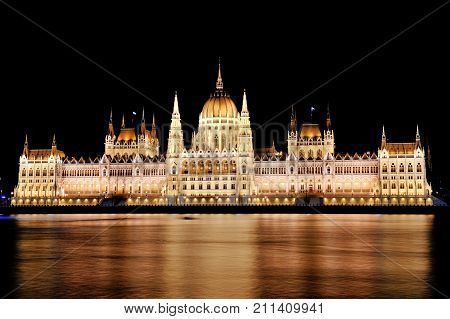 Budapest Hungary Europe - scenic view of the Parliament and Danube river at night