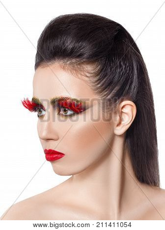 fashion portrait of beautiful woman with vivid creative makeup isolated on white. Red lips. Makeup for party. False eyelashes feathers. Beauty, fashion, art make up concept