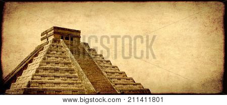 Grunge background with paper texture and landmark of Mexico - ancient Mayan pyramid (Kukulcan Temple), Chichen Itza, Yucatan