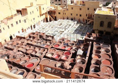 Coloration of leather in a traditional tannery in the city Fes, Morocco. Leather is colored with natural pigments and minerals of different colors