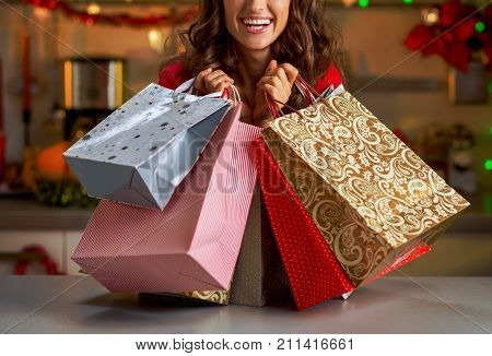 Smiling Young Woman With Christmas Shopping Bags In Christmas De