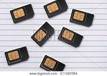 SIM cards are paper lined with a line of dark SIM cards