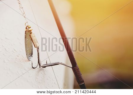 Fishing, close-up fishing pole, hook and baits for fishing