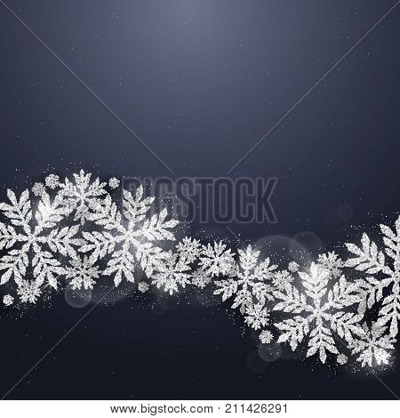 Christmas and new year dark blue background with christmas wave made of silver glittering snowflakes on dark background. Merry Christmas greeting card