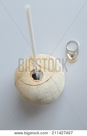 Fresh coconut with can open tool on top ready to drink