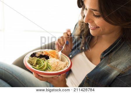 Woman Eating A Vegan Bowl