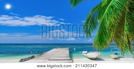 Wooden Bridge Juts Out Into  Of The Sea Dominican Republic