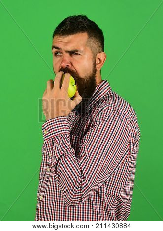 Farmer With Confused Face Bites Fresh Fruit.