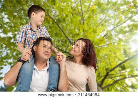 Happy smiling family son elementary age pre-adolescent child green