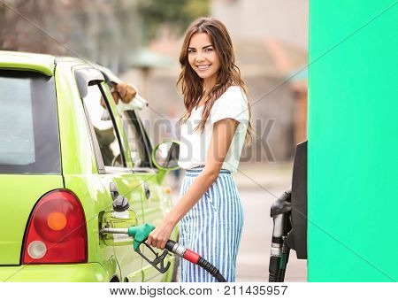 Woman refueling car on petrol station
