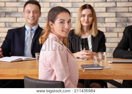 Human resources commission interviewing woman at table