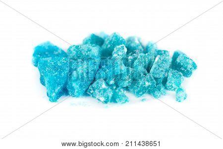 Blue crystal of methamphetamine isolated on white background.