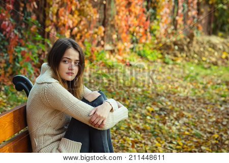 Autumn Girl At Red Color Leaves On Fence, Loneliness