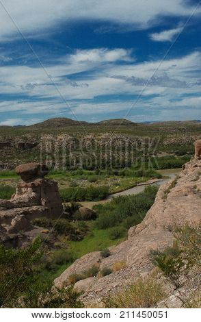 View of mountains of Mexico and igneous rock formations from the River Road (RM 170) over the Rio Grande River.