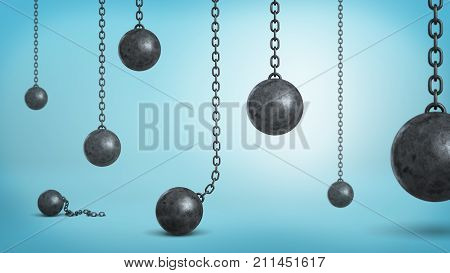 3d rendering of a many black iron wrecking balls hanging on chains and fallen down on blue background. Business and success. Dangers and risks. Difficult path to success.