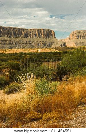 View from river road from Terlingua to Presidio, outside Big Bend National Park, Texas.  Cliffs in distance are across the Rio Grande river and in Mexico.