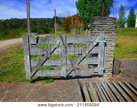Rustic gate. Rural gate. Wood gate. Wood door