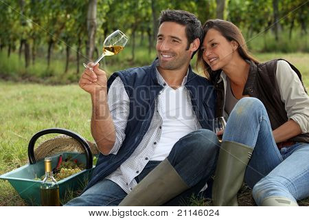 Couple taking a break from picking grapes
