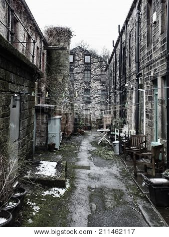 traditional west yorkshire terraced houses with stone mill building in hebden bridge west yorkshire