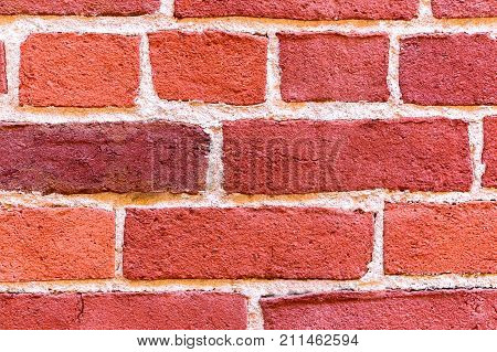 Close up of Textured Grunge Red Brick Wall