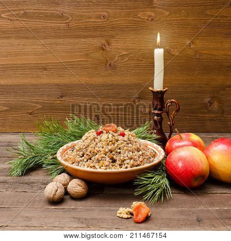 Plate With Traditional Christmas Treat Slavs On Christmas Eve. Spruce Branch, Apples And Candle On A