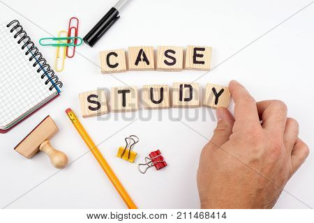 case study. Wooden letters on a white background.
