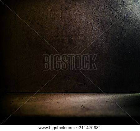 Dark stone or concrete room with incoming light.