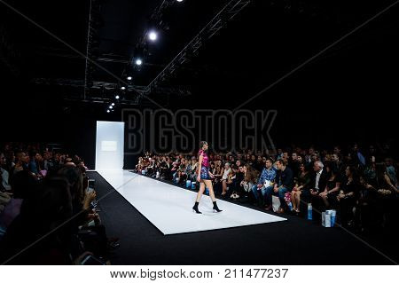 MOSCOW RUSSIA - OCTOBER 28 2017: Model walk runway for ALINA ASSI catwalk at Spring-Summer 2018 Season Moscow Fashion Week.