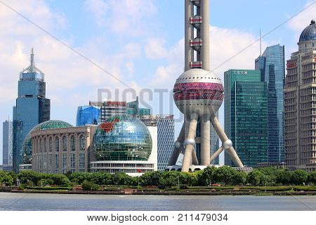The Pudong financial district in Shanghai with the Oriental Pearl Radio and TV Tower in the foreground. Image taken 16 September 2017 from the Bund.