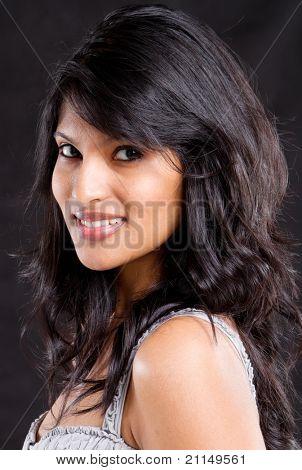 young fashion woman studio portrait on black