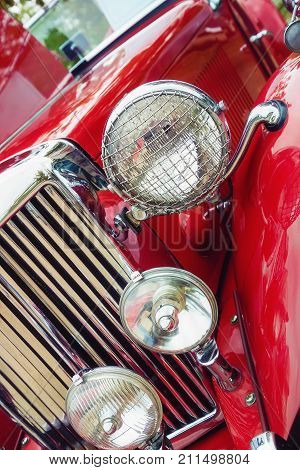 Westlake Texas - October 21 2017: Closeup of headlights and the grille of a red 1951 MG TD classic car.