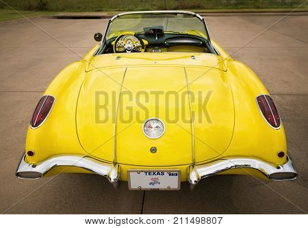 Westlake Texas - October 21 2017: A rear view of a yellow 1958 Corvette Chevrolet classic car.