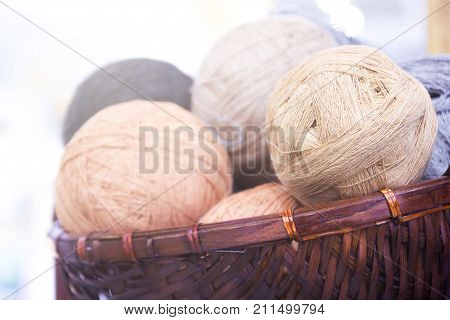 Balls Of Yarn In Basket On Wooden Background And Copy Space.
